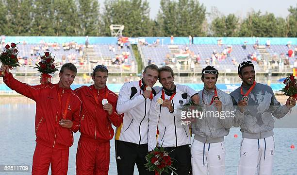 Germany's Martin Hollstein and Andreas Ihle Denmark's Kim Wraae Knudsen and Rene Holten Poulsen and Italy's Andrea Facchin and Antonio Scaduto...