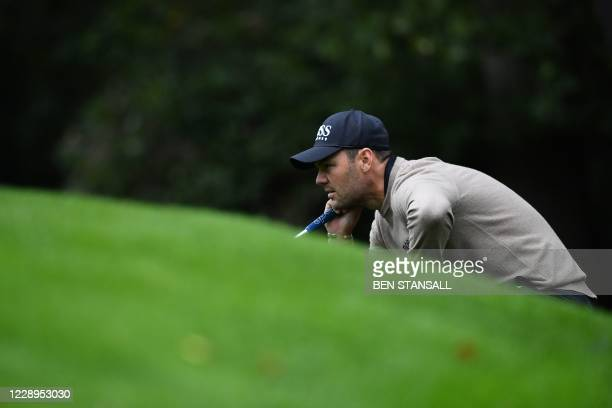 Germany's Martin Kaymer lines up a putt on the 16th hole on Day 1 of PGA Championship at Wentworth Golf Club in Surrey, south west of London on...