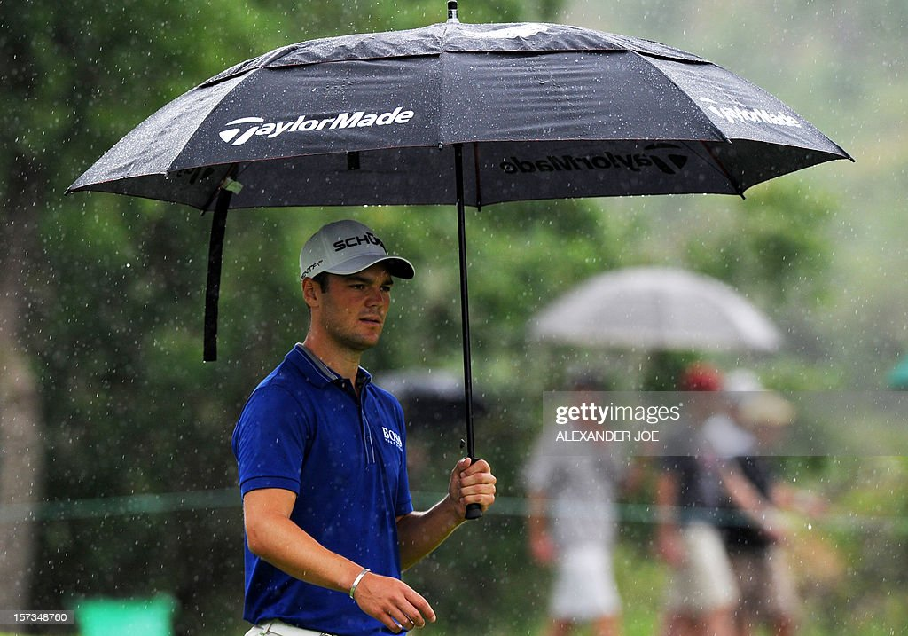 Germany's Martin Kaymer walks in the rain to a shot on the 7th during the 2012 Nedbank Golf Challenge in Sun City on December 2, 2012. Kaymer won the tournament. PHOTO / Alexander Joe