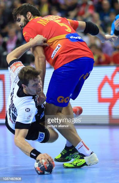 Germany's Martin Strobel against Spain's Jorge Maqueda during the final of the 2016 EHF European Men's Handball Championship between Germany and...