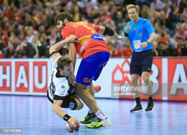 Germany's Martin Strobel in action against Spain's Jorge Maqueda during the 2016 EHF European Men's Handball Championship final betweenGermany and...