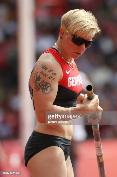 Germany's Martina Strutz prepares her pole in the Women's Pole Vault Qualification at the 15th International Association of Athletics Federations...