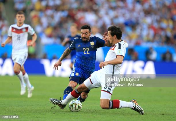 Germany's Mats Hummels and Argentina's Ezequiel Lavezzi battle for the ball during the FIFA World Cup Final at the Estadio do Maracana Rio de Janerio...