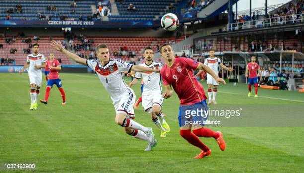 Germany's Matthias Ginter and Aleksandar Pesic of Serbia vie for the ball during the UEFA Under21 European Championships 2015 group A soccer match...