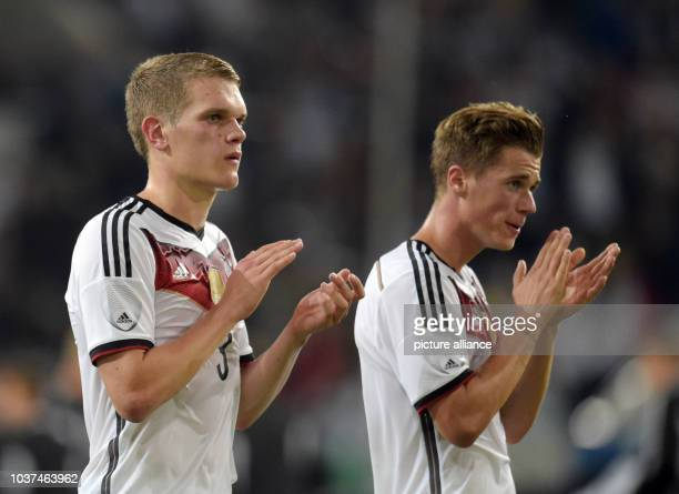 Germany's Matthias Ginter and Erik Durm clap hands as they walk off the pitch after the international match between Germany vs Argentina at Esprit...