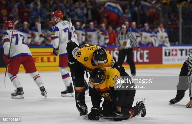 Germany´s Matthias Plachta and Moritz Muller react during the IIHF Ice Hockey World Championships first round match between Germany and Russia in...