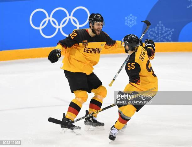 TOPSHOT Germany's Matthias Plachta celebrates scoring a goal in the men's semifinal ice hockey match between Canada and Germany during the...