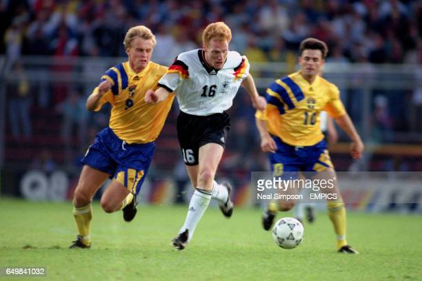 Germany's Matthias Sammer gets away from Sweden's Jonas Fern and Anders Limpar