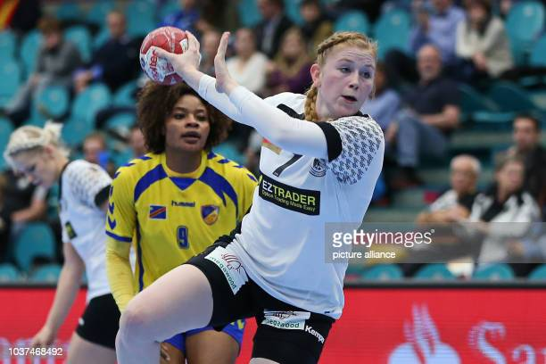 Germany's Meike Schmelzer in action against the Congo's Christianne Mwange Mwasesa during a handball match between Germany and the DR Congo at the...