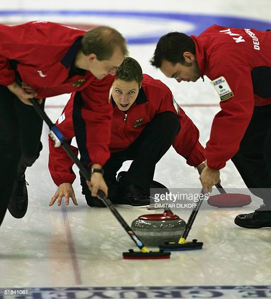 Germany's men team Daniel Herberg Markus Messenzehl and Stephan Knoll play a stone during their encounter against Norway at the European Curling...