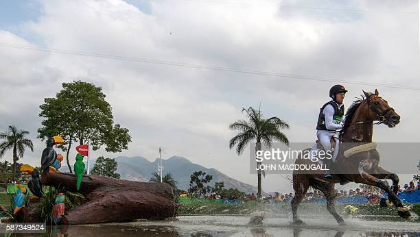 Germany's Michael Jung competes in the Eventing's Cross Country phase of the Equestrian competition during the Rio 2016 Olympic Games at the Olympic...