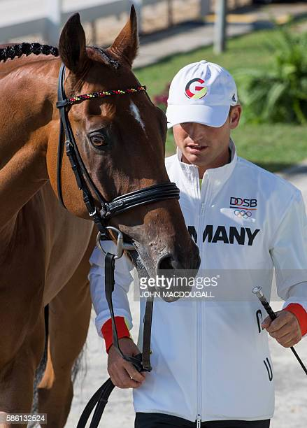 Germany's Michael Jung leads Sam FBW to a trot during the first horse inspection of the Equestrian's Eventing phase during the 2016 Rio Olympic Games...
