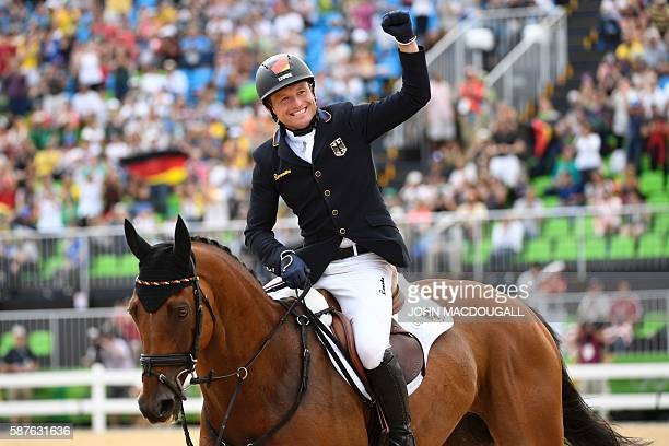 Germany's Michael Jung on Sam Fbw celebrates winning the Eventing's Individual Jumping of the Equestrian during the 2016 Rio Olympic Games at the...