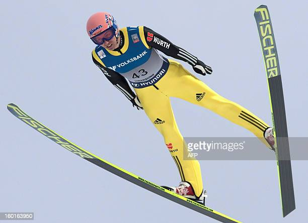 Germany's Michael Neumayer competes during the FIS Ski Jumping World Cup in Vikersund central Norway on January 27 2013 Slovenia's Robert Kranjec won...