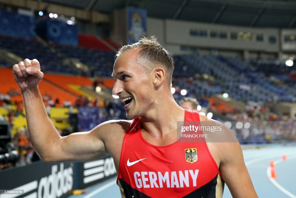 Germany's Michael Schrader celebrates after finishing the men's decathlon 1500 metres event and taking overall silver at the 2013 IAAF World Championships at the Luzhniki stadium in Moscow on August 11, 2013.