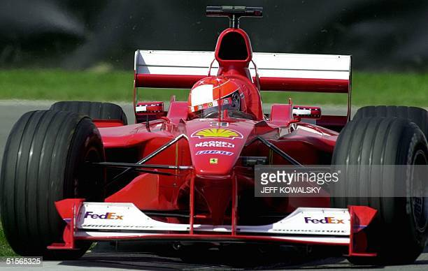 Germany's Michael Schumacher of team Ferrari takes a turn during a practice run at the US Grand Prix track 22 September at the Indianapolis Motor...