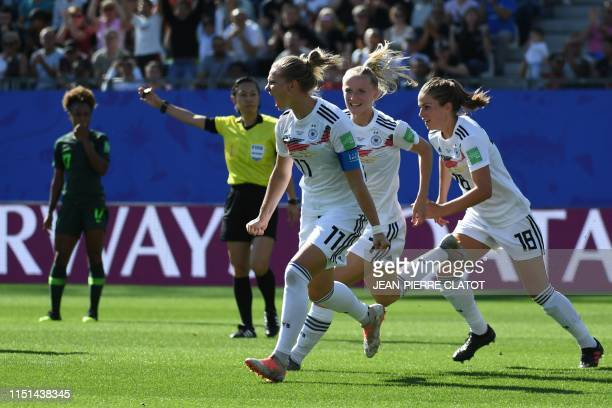 TOPSHOT Germany's midfielder Alexandra Popp celebrates after scoring a goal during the France 2019 Women's World Cup round of sixteen football match...