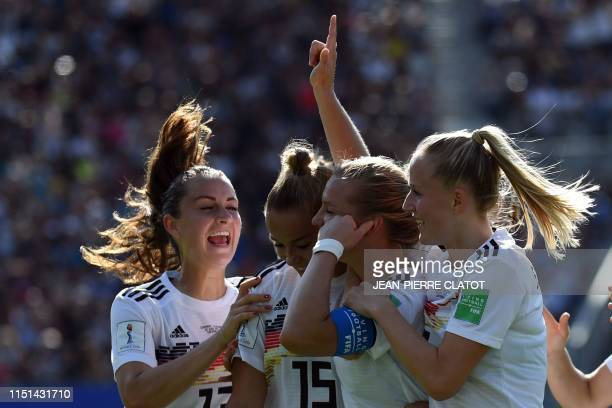 TOPSHOT Germany's midfielder Alexandra Popp is congratulated by teammates after scoring a goal during the France 2019 Women's World Cup round of...