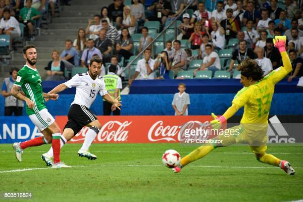Germany's midfielder Amin Younes kicks the ball to score past Mexico's goalkeeper Guillermo Ochoa during the 2017 FIFA Confederations Cup semifinal...