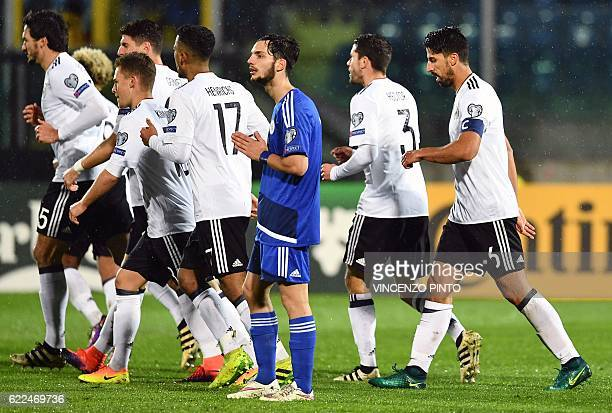Germany's midfielder and captain Sami Khedira celebrates with teammates after scoring a goal during the World Cup 2018 qualifying football match...