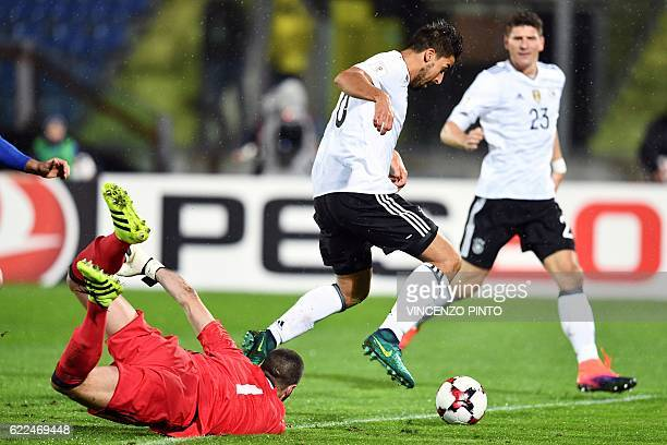 Germany's midfielder and captain Sami Khedira scores a goal during the World Cup 2018 qualifying football match between San Marino and Germany on...