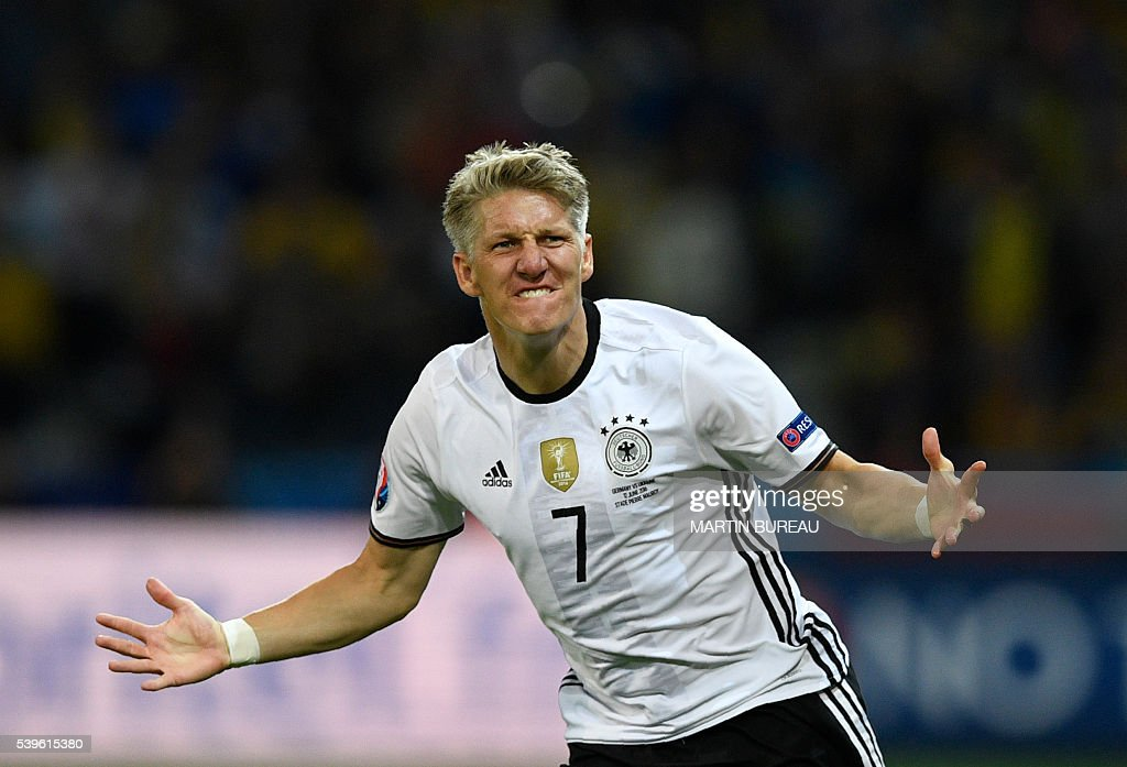 Germany's midfielder Bastian Schweinsteiger celebrates after scoring a goal during the Euro 2016 group C football match between Germany and Ukraine at the Stade Pierre Mauroy in Villeneuve-d'Ascq near Lille on June 12, 2016. / AFP / MARTIN
