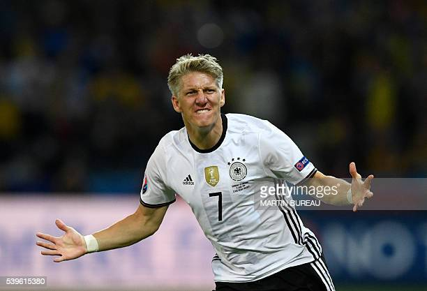 Germany's midfielder Bastian Schweinsteiger celebrates after scoring a goal during the Euro 2016 group C football match between Germany and Ukraine...
