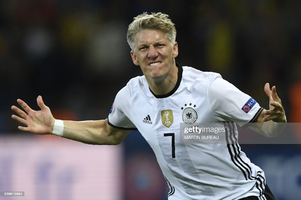 TOPSHOT - Germany's midfielder Bastian Schweinsteiger celebrates after scoring a goal during the Euro 2016 group C football match between Germany and Ukraine at the Stade Pierre Mauroy in Villeneuve-d'Ascq near Lille on June 12, 2016. /