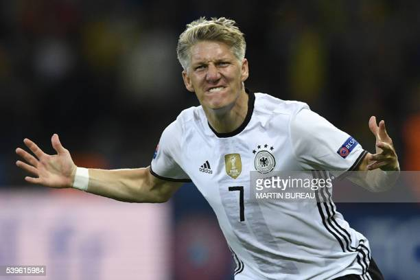 TOPSHOT Germany's midfielder Bastian Schweinsteiger celebrates after scoring a goal during the Euro 2016 group C football match between Germany and...