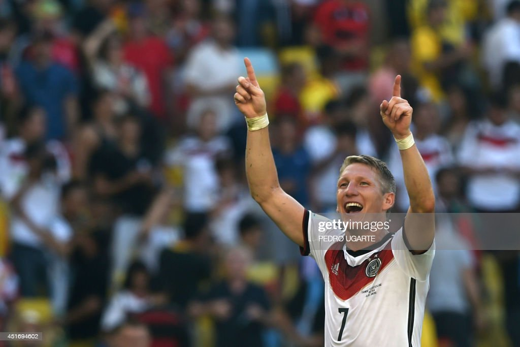 Germany's midfielder Bastian Schweinsteiger celebrates after winning the quarter-final football match between France and Germany 1-0 at the Maracana Stadium in Rio de Janeiro during the 2014 FIFA World Cup on July 4, 2014. AFP PHOTO / PEDRO UGARTE / AFP PHOTO / Pedro UGARTE