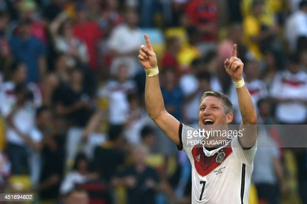 Germany's midfielder Bastian Schweinsteiger celebrates after winning the quarterfinal football match between France and Germany 10 at the Maracana...
