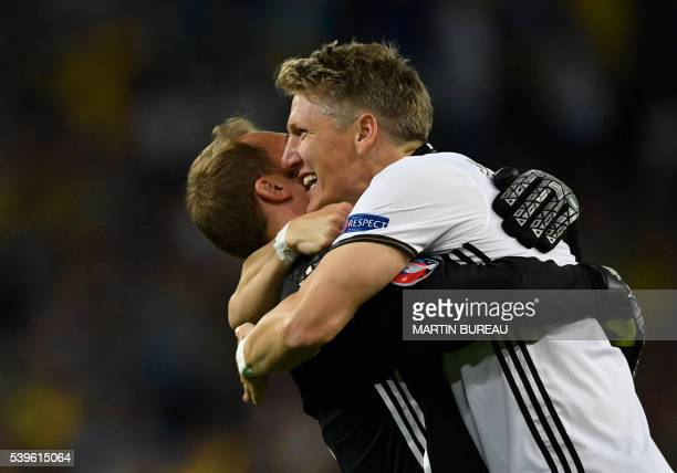 TOPSHOT Germany's midfielder Bastian Schweinsteiger celebrates with Germany's goalkeeper Manuel Neuer after scoring a goal during the Euro 2016 group...