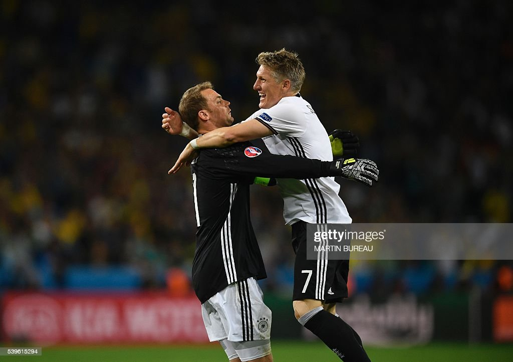 Germany's midfielder Bastian Schweinsteiger (R) celebrates with Germany's goalkeeper Manuel Neuer after scoring a goal during the Euro 2016 group C football match between Germany and Ukraine at the Stade Pierre Mauroy in Villeneuve-d'Ascq near Lille on June 12, 2016. / AFP / MARTIN