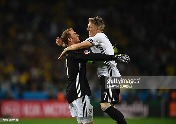 Germany's midfielder Bastian Schweinsteiger celebrates with Germany's goalkeeper Manuel Neuer after scoring a goal during the Euro 2016 group C...