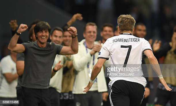 TOPSHOT Germany's midfielder Bastian Schweinsteiger celebrates with Germany's coach Joachim Loew after scoring a goal during the Euro 2016 group C...