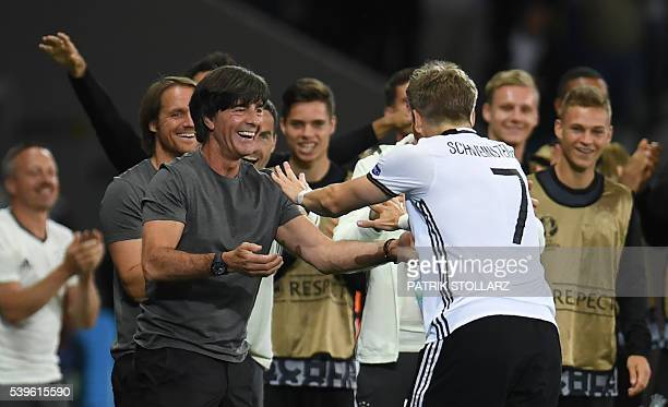 Germany's midfielder Bastian Schweinsteiger celebrates with Germany's coach Joachim Loew after scoring a goal during the Euro 2016 group C football...