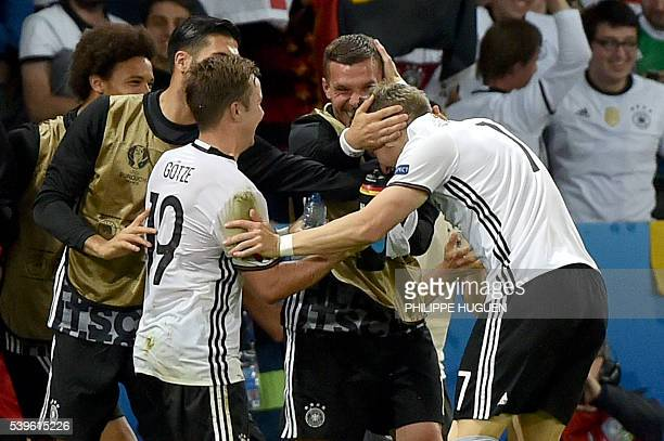 Germany's midfielder Bastian Schweinsteiger celebrates with teammates after scoring a goal during the Euro 2016 group C football match between...