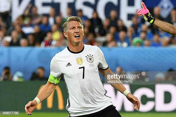 Germany's midfielder Bastian Schweinsteiger reacts as his goal is disallowed during the Euro 2016 quarterfinal football match between Germany and...
