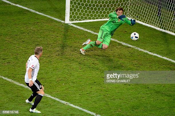 Germany's midfielder Bastian Schweinsteiger scores a goal during the Euro 2016 group C football match between Germany and Ukraine at the Stade Pierre...
