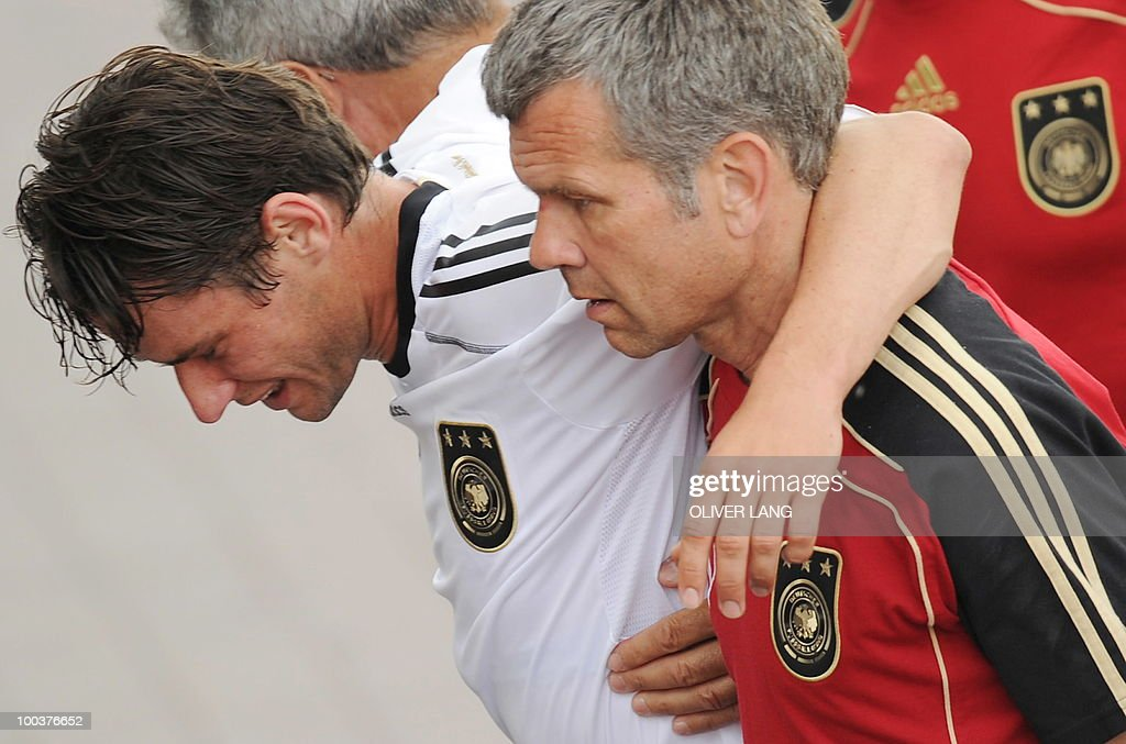 Germany's midfielder Christian Traesch (L) is walked out of the training center by team medics after sustaining a foot injury during a training match against Sued Tyrol FC at the team's training centre in Appiano, near the north Italian city of Bolzano May 24, 2010. The German football team is currently taking part in a 12-day training camp in Appiano to prepare for the upcoming FIFA Football World Cup in South Africa.