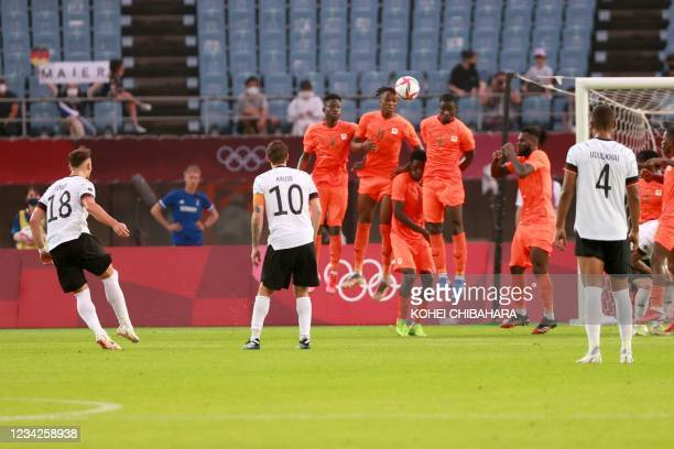 Germany's midfielder Eduard Loewen scores from a free kick during the Tokyo 2020 Olympic Games men's group D first round football match between...