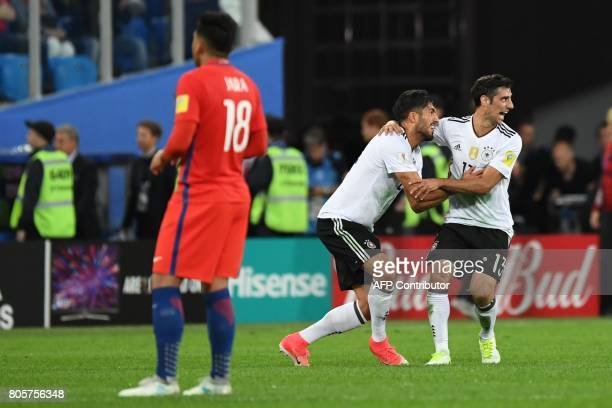 Germany's midfielder Emre Can and Germany's midfielder Lars Stindl celebrate as they beat Chile 10 to win in the 2017 Confederations Cup final...