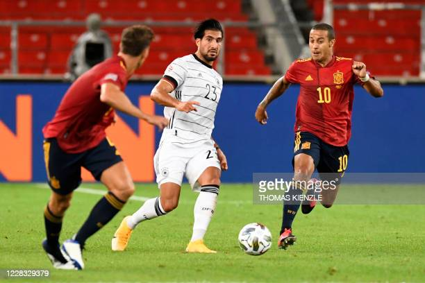 Germany's midfielder Emre Can and Spain's midfielder Thiago Alcantara vie for the ball during the UEFA Nations League football match between Germany...
