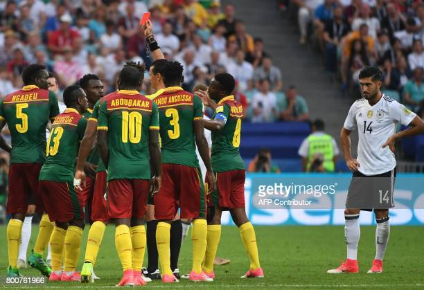 Germany's midfielder Emre Can reacts as Colombian referee Wilmar Roldan gives a red card to Cameroon's defender Ernest Mabouka during the 2017 FIFA...