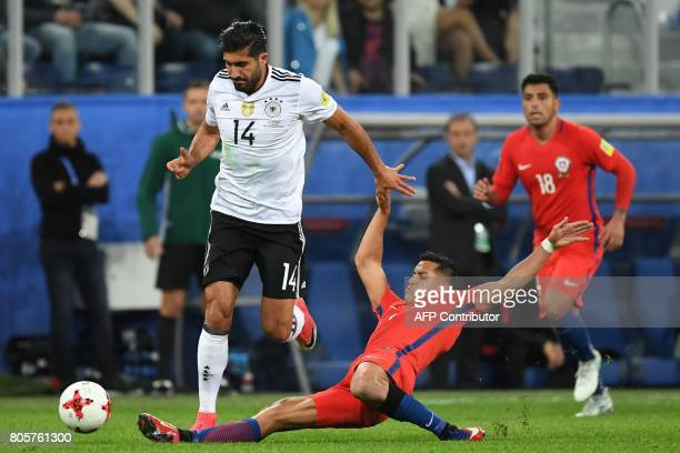 Germany's midfielder Emre Can vies with Chile's forward Alexis Sanchez during the 2017 Confederations Cup final football match between Chile and...