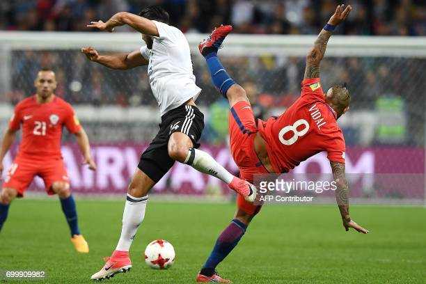 TOPSHOT Germany's midfielder Emre Can vies with Chile's midfielder Arturo Vidal during the 2017 Confederations Cup group B football match between...