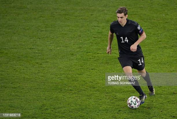Germany's midfielder Florian Neuhaus runs with the ball during the FIFA World Cup Qatar 2022 qualification football match Germany v Iceland in...