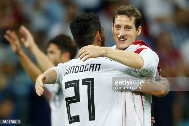Germany's midfielder Ilkay Gundogan and Germany's midfielder Sebastian Rudy celebrate after winning at the end of the Russia 2018 World Cup Group F...