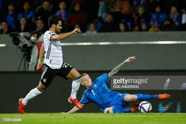 Germany's midfielder Ilkay Gundogan and Iceland's defender Birkir Saevarsson vie for the ball during the FIFA World Cup Qatar 2022 qualification...