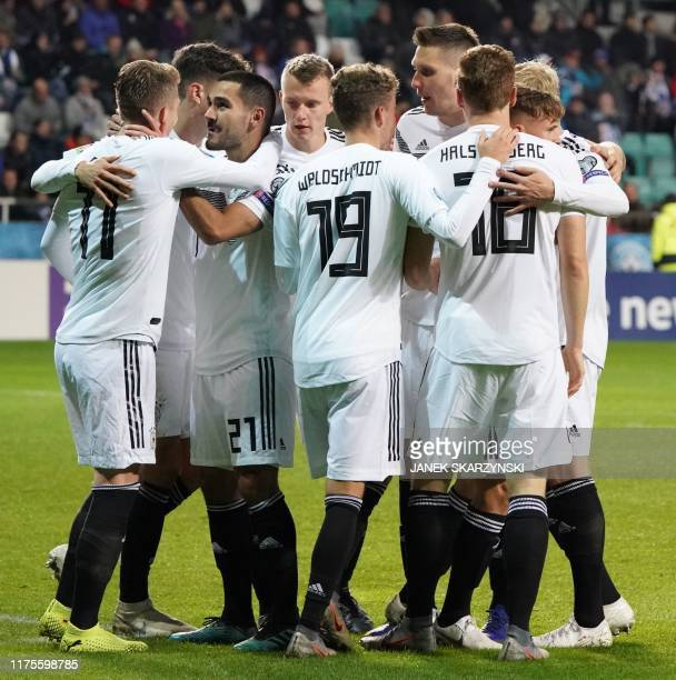 Germany's midfielder Ilkay Gundogan celebrates scoring with his team-mates during the Euro 2020 qualifier Group C Estonia v Germany in Tallinn,...